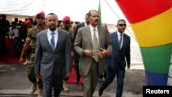 FILE - Eritrea's President Isaias Afwerki and Ethiopia's Prime Minister Abiy Ahmed arrive for an inauguration ceremony marking the reopening of the Eritrean embassy in Addis Ababa, Ethiopia, July 16, 2018.