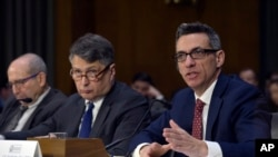 FILE - Clinton Watts, right, a Senior Fellow at the Foreign Policy Research Institute Program on National Security, testifies before the Senate Intelligence Committee hearing on Capitol Hill in Washington, March 30, 2017, on Russian intelligence activities.