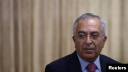 FILE - Then-Palestinian Prime Minister Salam Fayyad attends an opening reception of Conference on Cooperation among East Asian Countries for Palestinian Development in Tokyo.