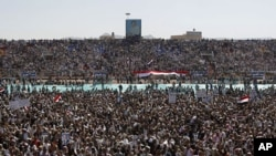 A large portrait of Yemen's President Ali Abdullah Saleh is seen as supporters gather at a soccer stadium for Saleh to speak in Sanaa March 10, 2011