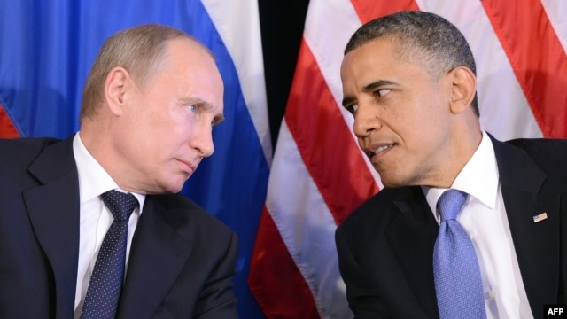 U.S. President Barack Obama (R) listens to Russian President Vladimir Putin after their bilateral meeting in Los Cabos, Mexico on June 18, 2012, on the sidelines of the G20 summit.