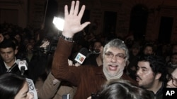 Paraguay's former President Fernando Lugo waves to followers gathered outside the Public Television building in downtown Asuncion, June 24, 2012.