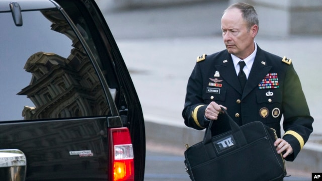 National Security Agency Director General Keith Alexander leaves the White House in Washington, Oct. 2, 2013.