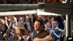 "Hugh Jackman and Dakota Goyo star as a father and son who reconnect with the help of a prize-fighting robot in ""Real Steel."""