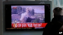 "A South Korean man watches a TV news showing a file footage of North Korea's nuclear test at the Seoul train station in Seoul, South Korea, Tuesday, Feb. 12, 2013. The U.S. Geological Survey on Tuesday detected a magnitude 4.9 earthquake in North Korea. Neither Pyongyang nor Seoul confirmed whether North Korea had conducted its widely anticipated third nuclear test, though an analyst in Seoul said a nuclear detonation was a ""high possibility."" (AP Photo/Lee Jin-man)"