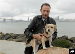 This 2011 photo shows Timothy Ray Brown, the only man ever known to have been apparently cured from AIDS, with his dog, Jack, on Treasure Island in San Francisco. (Courtesy Photo)