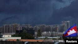 FILE: Buildings under construction are pictured beneath dark clouds in Phnom Penh, Cambodia, June 18, 2018.