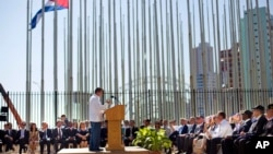 Cuban-American Poet Richard Blanco reads a poem during the reopening ceremony of the U.S. embassy in Havana, Cuba, Aug. 14, 2015.