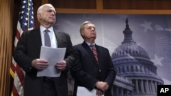 FILE - Sen. John McCain, R-Ariz., (left) and Sen. Lindsey Graham, R-S.C., wait to speak during a news conference on Capitol Hill in Washington.