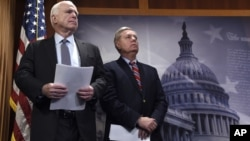 FILE - Sen. John McCain, R-Ariz., (left) and Sen. Lindsey Graham, R-S.C., wait to speak during a news conference on Capitol Hill in Washington, Jan. 21, 2016.