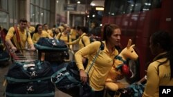 FILE - Australia's Olympic athletes arrive at the Tom Jobim International Airport in Rio de Janeiro, Brazil, July 26, 2016.