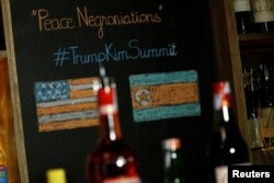 """A bar sells a cocktail named """"Peace Negroniations"""" to commemorate a US-DPRK summit at Tannin Wine Bar in Hanoi, Vietnam February 20, 2019. REUTERS/Kham"""