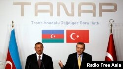 FILE - Turkey's Prime Minister Recep Tayyip Erdogan, right, and Azerbaijan's President Ilham Aliyev hold a news conference following a signing ceremony in Istanbul, June 26, 2012.