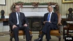 Presiden Barack Obama menerima kunjungan PM Irak Nouri al-Maliki (kiri) di Gedung Putih (12/12).