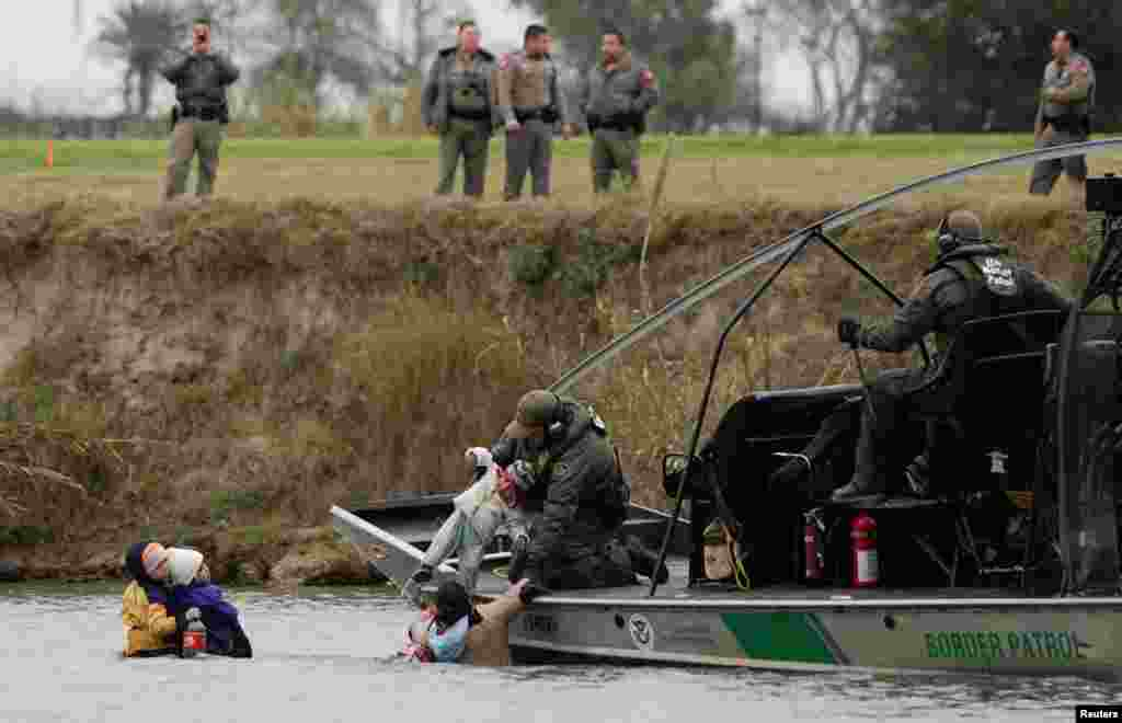 A U.S. border patrol boat rescues migrants crossing the Rio Bravo towards the United States, seen from Piedras Negras, Mexico, Feb. 10, 2019.