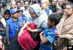 Bangladeshi Prime Minister Sheikh Hasina, center, meets with Rohingya Muslims at Kutupalong refugee camp, near the border town of Ukhia, Bangladesh, Sept. 12, 2017.