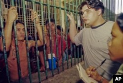 Paco Larrañaga, here at the BBRC jail in Cebu City, is accused of killing two sisters in the Philippines in 1997.