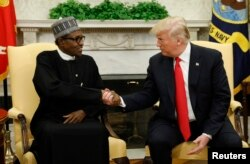 U.S. President Donald Trump meets with Nigeria's President Muhammadu Buhari in the Oval Office of the White House in Washington, April 30, 2018.