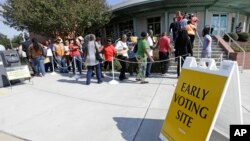 FILE - Voters line up during early voting in Raleigh, North Carolina, Oct. 20, 2016.