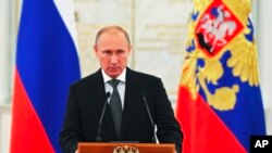 FILE - Russian President Vladimir Putin speaks at a meeting with senior officers in the Kremlin in Moscow.