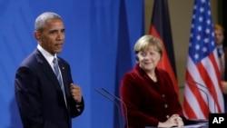 صدر اوباما برلن میں جرمن چانسلر اینگلا مرکل کے ہمراہ مشترکہ پریس کانفرنس میں۔17 نومبر 2016