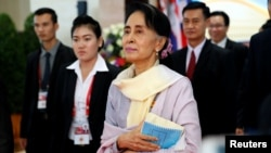 FILE - Myanmar State Counselor Aung San Suu Kyi walks between meetings at the ASEAN Summit in Vientiane, Laos Sept. 6, 2016.