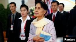 FILE - Myanmar State Counselor Aung San Suu Kyi walks between meetings at the ASEAN Summit in Vientiane, Laos Sept. 6, 2016.