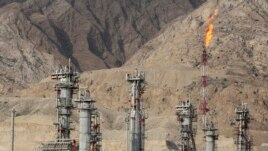 A gas flare burns in a gas refinery in South Pars gas field, on the northern coast of the Persian Gulf, in Asalouyeh, Iran, Jan. 22, 2014.