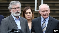 Sinn Fein leader Gerry Adams (L) and Sinn Fein politician and Northern Ireland's Deputy First Minister, Martin Mcguinness (R) speak during a press conference outside Stormont Castle in Belfast, Northern Ireland on June 24, 2016, following the result of the United Kingdom's June 23 referendum on whether or not to leave, or remain in the European Union (EU).