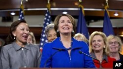 House Minority Leader Nancy Pelosi, accompanied by women House Democrats, announces during a news conference on Capitol Hill that she wants to remain as the top Democrat in the House of Representatives, Nov. 14, 2012.