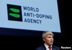 FILE - Pavel Kolobkov, Minister of Sport of Russia addresses the Symposium of the World Anti Doping Agency (WADA) in Ecublens, Switzerland, March 13, 2017.