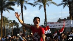 Protesters chant slogans as they march following an attack by security forces in Tahrir Square, in Cairo, Egypt, Saturday, April 9, 2011