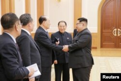 North Korean leader Kim Jong Un meets members of the high-level delegation of the Democratic People's Republic of Korea, which visited South Korea to attend the opening ceremony of the 23rd Winter Olympics.