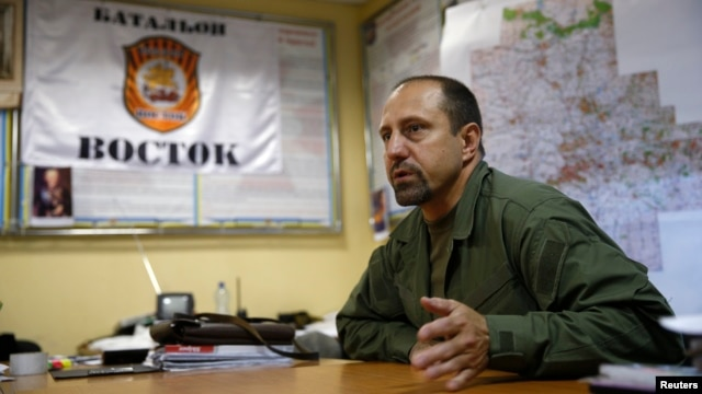 "FILE - Rebel commander Alexander Khodakovsky of the so-called Vostok battalion - or ""Eastern"" battalion - speaks during an interview in Donetsk, July 8, 2014."