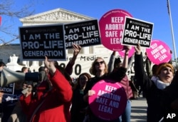 FILE - Protesters on both sides of the abortion issue are seen gathered outside the U.S. Supreme Court in Washington, Jan. 19, 2018.