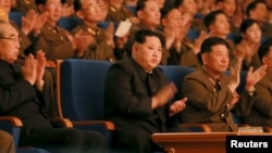 North Korean leader Kim Jong Un, center, applauds during a concert in this undated photo released by North Korea's Korean Central News Agency (KCNA) in Pyongyang, Feb. 23, 2016. U.N. diplomats told reporters about a new sanctions agreement Wednesday, a day before the U.N. Security Council is set to hold closed consultations on the issue.
