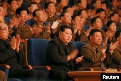 FILE - North Korean leader Kim Jong Un (C) applauds during a concert marking the 70th founding anniversary of the Korean People's Army (KPA) military band in this undated photo released by North Korea's Korean Central News Agency (KCNA) in Pyongyang.