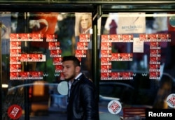 """Yes"" stickers with pictures of Turkish President Recep Tayyip Erdogan are placed at a bus stop, in Istanbul, Turkey, April 14, 2017."