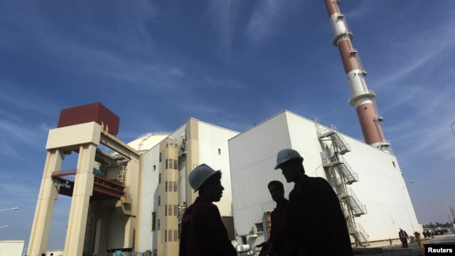 FILE - Iranian workers stand in front of the Bushehr nuclear power plant, about 1,200 kilometers south of Tehran.