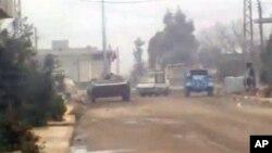 12月24號的業餘攝影畫面顯示開進霍姆斯市的敘利亞政府軍車