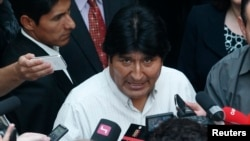 Bolivian President Evo Morales talks to journalists at the Vienna International Airport in Schwechat, July 3, 2013.