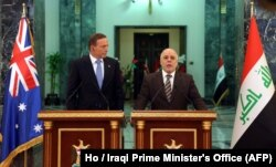 Iraq Prime Minister Haider al-Abadi, right, and his Australian counterpart, Tony Abbott, take part in a press conference in Baghdad, Jan. 4, 2015.