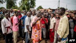 Joseph Bendounga (C), a local opposition leader, speaks to a crowd of people angered by an attack on a church in central Bangui, May 29, 2014.