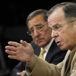 Defense Secretary Leon Panetta looks as Joint Chiefs Chairman Admiral Mike Mullen, front, speaks Tuesday near Washington.