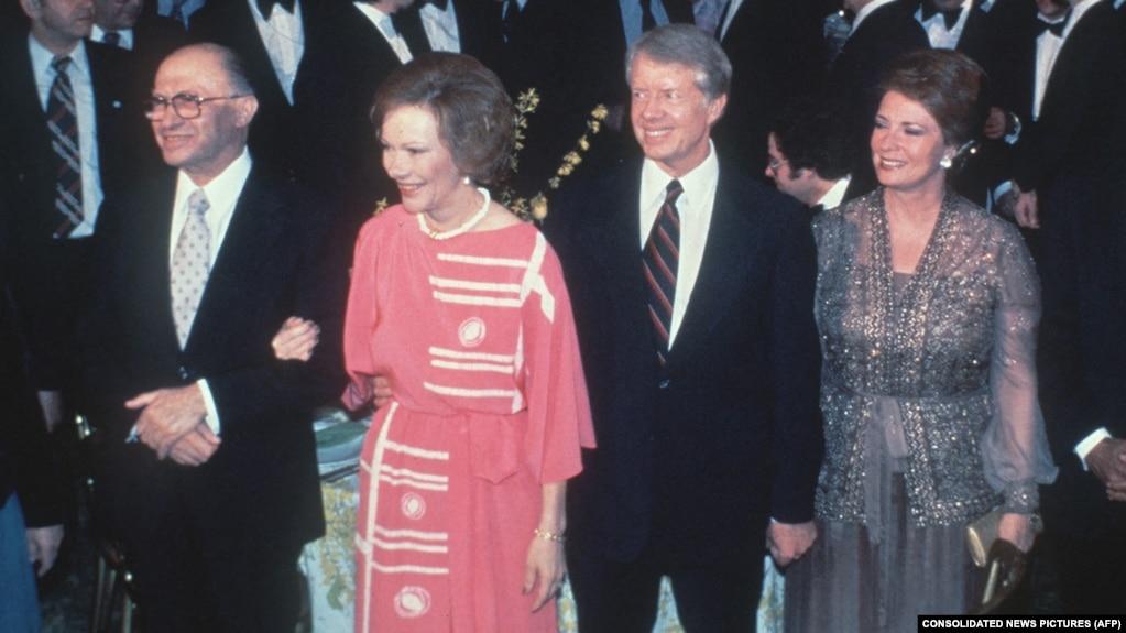 Couples présidentiels : Les Égyptiens Anwar al-Sadat et Jihan al-Sadat, et les Américains Jimmy Carter et Rosalynn Carter à la Maison Blanche, le 26 mars 1979.