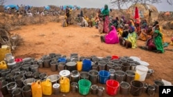 People wait for food and water in the Warder district in the Somali region of Ethiopia, Jan. 28, 2017. Ethiopia is struggling to counter a new drought in its east that authorities say has left 5.6 million people in need.