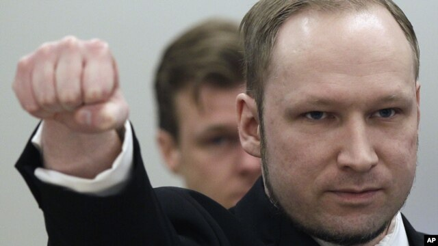 FILE - Mass murderer Anders Behring Breivik arrives at the courtroom in Oslo, Norway, April 16, 2012.