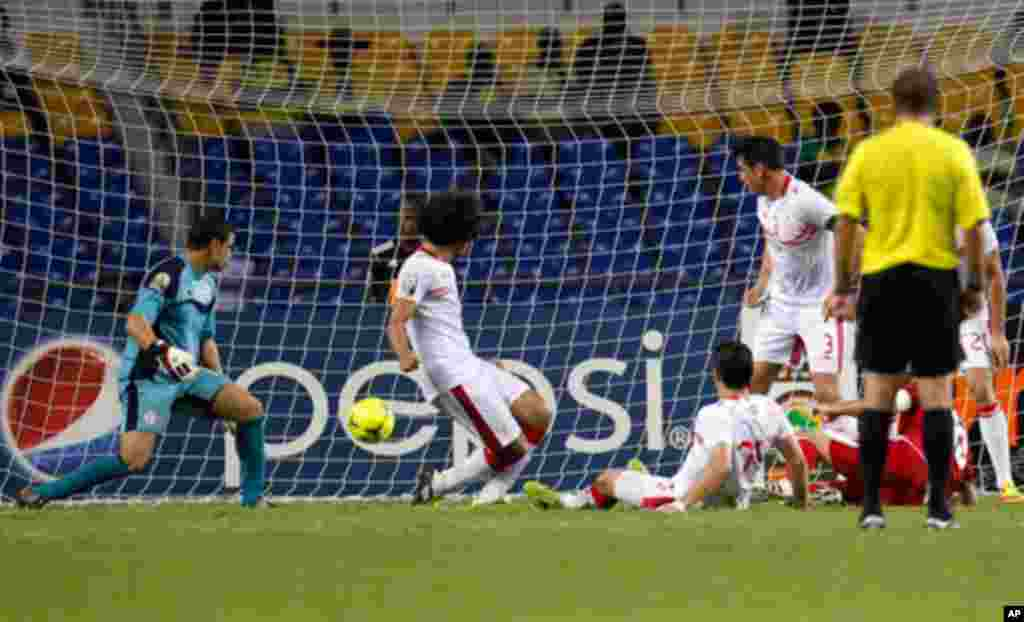 Morocco's Houssine scores against Tunisia during their African Cup of Nations soccer match in Libreville