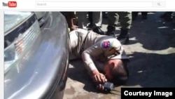 Chhean Pisith, a border police officer, was recorded collapsing in front of a car owned by Din Puthy, a local Cambodia National Rescue Party official in Poipet (Courtesy of YouTube.com).