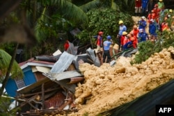 Rescuers search for survivors at the landslide site in Naga City, on the popular tourist island of Cebu, Sept. 20, 2018. At least three people were killed and 10 homes buried early Thursday in the central Philippines when heavy monsoon rains unleashed a landslide.